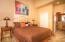 Junior suite with lighted closet, vaulted ceiling and access to second bathroom