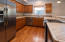 The kitchen with stainless appliances.