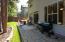 The newly landscaped and fully fenced back yard with large patio.