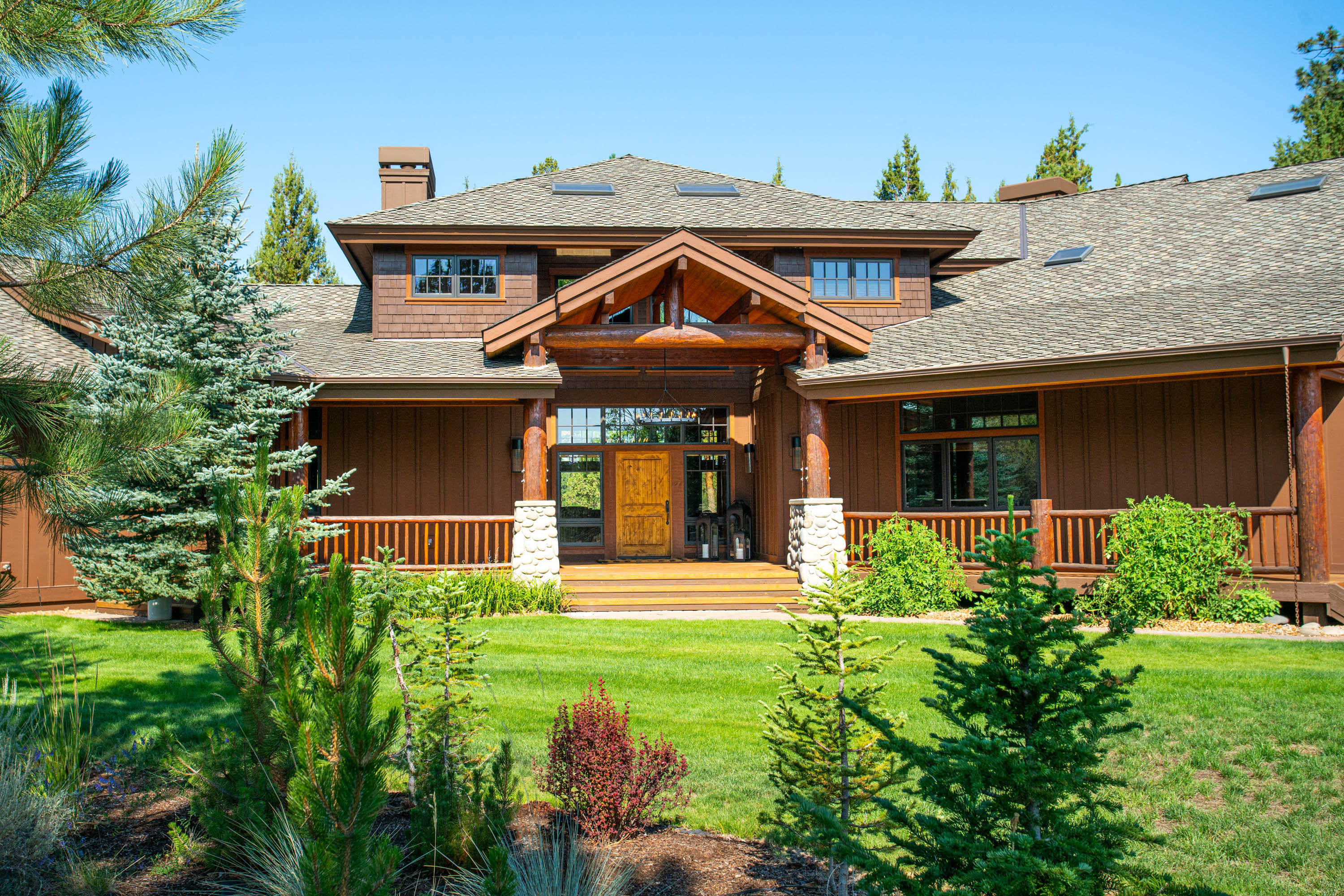 Prime location in Tumalo, peaceful and private, with views of the Cascade Mountains. This extraordinary home, built by Sun Forest Construction, is sited on 5.23 acres, treed and fenced, with underground irrigation. The Northwest design has ranch and log accents, and many quality features. The light filled great room has a majestic stone fireplace and a wall of windows looking over the rear deck and landscaped yard. Perfect for entertaining and family gatherings, the adjoining dining area has a buffet and is open to the spacious kitchen, which features a wall fireplace, large island, breakfast bar and pantry . There is good separation of the master suite, and the guest suite and den, all on the main level. Upstairs, the large loft provides a comfortable space for relaxing. A third guest suite and small office are also up. The large 3-car garage has lots of storage. The barn is extra special, with 3 horse stalls, storage and an office, plus an outdoor corral. Truly a special property!