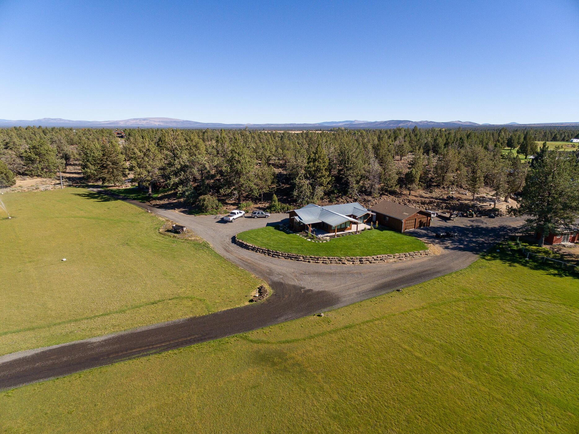 39 PRISTINE, FLAT & USABLE ACRES with huge mountain views, gorgeous pond and underground irrigation. Two separate homes; the main house is 1612sf, cottage is 1172sf, plus a 611sf bunkhouse adjoining the 35x59 drive-thru shop. Pride of ownership shines throughout land and buildings. Bring your horses! 1/3mile to BLM land , 28x76 covered horse set-up w/tack room and washing stations as well as 140x280 arena area. 20.3 acres water rights.