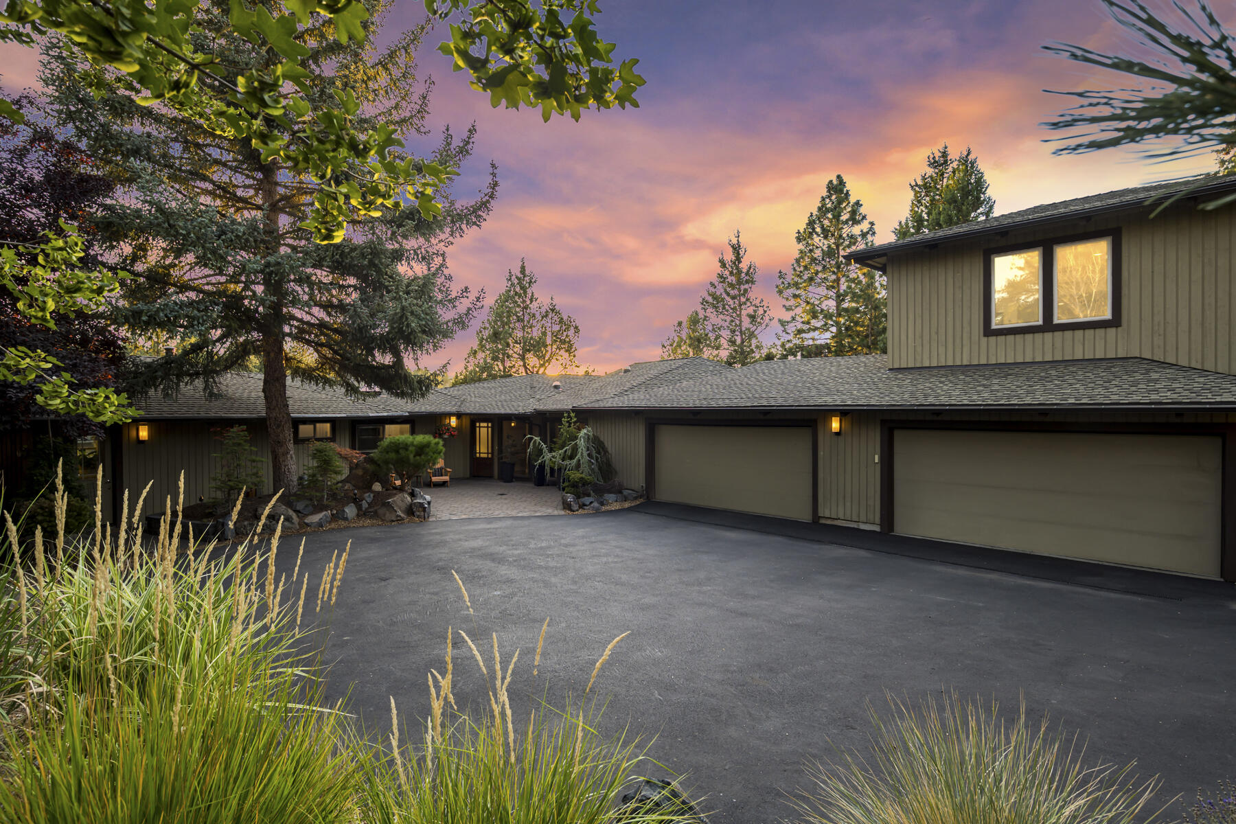 Perched high above the Deschutes River and surrounded by mature trees and lush landscaping, this magnificent property is perfectly positioned to maximize its breathtaking views of the river canyon, Broken Top, and the Three Sisters. Soak in this extraordinary setting from the back deck dining area or hot tub, or from the stunning living room, where wraparound windows frame the river view. High-end touches include acacia wood flooring, a floor-to-ceiling lava rock fireplace, granite countertops and a 5-burner Thermador range in the remodeled gourmet kitchen, and a built-in wine refrigerator in the dining area. One of two full suites in the home, the owner's suite features floor-to-ceiling windows with river and mountain views and a luxurious bath with dual walk-in closets, dual shower heads, and heated travertine floors. Enjoy a 5-car garage with extensive storage and a 50' RV parking area. An additional living suite over the garage offers a separate entry and privacy for guests.