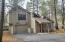 """The roof is metal """"tiles"""" with a composite coating that holds up well to the weather extremes of the high desert."""