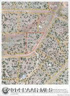 Photo of 33628 W El Capitan, Seligman, AZ a vacant land listing for 1.18 acres