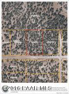 Photo of 33618 W El Caballo Road, Seligman, AZ a vacant land listing for 2.05 acres