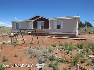 Photo of 50875 N Bobcat Kitten Trail, Seligman, AZ a single family manufactured home around 1400 Sq Ft., 3 Beds, 2 Baths