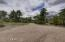 Driveway extends around the property for easy RV maneuvers.