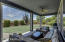 Large covered patio with ceiling fans to enjoy the outdoor spaces.