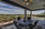 Alfresco dining with golf course views, ceiling fan with light to enjoy in the evening.