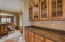 Convientently located between the kitchen and dining is a butlers pantry for serving and additional storage.