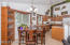 Sliding door by Dining Area opens to large covered & screened patio