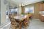 Diagonal Tiled Dining Area with Sliding Door & Sunny Windows & Designer Paint.