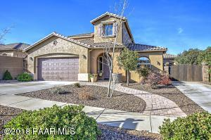 With New Upgraded Elastomeric Exterior Paint, Custom Stone & Paver Gates, Walkways & Patios, Upgraded Cement Tiled Roof, Upgraded 8' Tall Garage Doors, Pro-Landscaping with Drip Watering System and Mature Shade Trees!