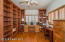 Bedroom 3 with walk-in closet & 2 walls of wonderful floor to ceiling built-ins ... could be the perfect office or library