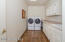 Front load washer and dryer remain ... there's a laundry tub, great counter space & cabinets ... adjacent to the Garage