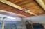 tongue and groove living room ceiling with beams