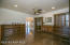 Rich cabinetry surrounds this study/formal dining