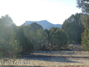 Photo of 38236 W Howling Coyote Road, Seligman, AZ a single family manufactured home around 1500 Sq Ft., 3 Beds, 2 Baths
