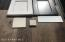 samples of flooring (right/bottom), tile(bathroom floors and showers), granite (all counters throughout) and white glass kitchen back splash, ebony finish cabinets on all cabinets, white finis cabinets on kitchen island