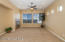 GreatRoom w/Cozy Tumbled Tile Fireplace, Media Niche, Recessed Lighting, Lighted Ceiling Fan, Sunny Windows, Horizontal Wood Blinds, French Door to Rear Yard & Mountain Views!