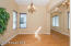 with Courtyard Views, Wood Plank Flooring, Upgraded Lighting, Sunny Windows & Horizontal Wood Blinds.