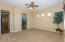 Spacious Master Bedroom with Sunny View Windows, Accent Windows, Lighted Ceiling Fan, 2 Tone Paint, French Door to Rear Patio, Wood Horizontal Blinds & carpet Flooring.