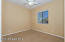 Good Sized Bedroom 2 with Sliding Door Closet, Carpet Flooring, 2 Tone Paint, Lighted Ceiling Fan, wood Horizontal Blinds.