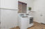 Spacious Laundry Rm with Washer & Dryer Included, Sunny Window, Tile Flooring, Laundry Shelf & Plumbed for Utility sink.