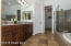 Tiled Flooring with Oval Soaking Tub, Clear Glass Enclosed Shower, Sunny Window w/ Wood Horizontal Blinds, Sandstone Marble Surrounds & Counter with Executive Height Cabinetry, Upgraded Lighting, Mirrored Medicine Cabinets, Private Toilet Rm & Big Walk In Closet.