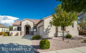 with Large Driveway, Stacked Stone & Stucco Finish, Block Wall & Iron Fencing, Keyless Entry, Custom Front Door Security Screen, Cement Tiled Roof & Relaxing Front Coffee Patio!