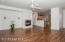 Tiled Entry Foyer with Coat Closet, Wood Laminate Flooring, Ceiling Fan, Surround Sound Speaker System, Media Niche, Cozy Tiled Fireplace with Art Niche, Sliding Door to Rear Yard & Spacious Covered Rear Patio.