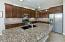 """Beautiful Granite Kitchen w/Island, Custom Cherrywood Cabinetry w/42"""" Uppers w/Upgraded Pewter Handles, Long Pullout Drawer Units & Pullout Shelves in Lower Cabinets. Beautiful Subway Tile Backsplash and Under Counter Lighting."""