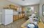 Kitchenette is Perfect for In Law Suite or Guest Suite. Includes Cabinetry, Small Refrig., Sink and Recessed Lighting.