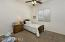 with Horizontal Blinds and Lighted Ceiling Fan.