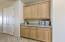 Nice Storage Here in the Granite Butlers Cabinet + Big Double Door Entry Kitchen Pantry.