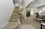 with Arched Entry Accents, Coat Closet & Upgraded Iron & Wood Stair Case.