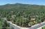 Rear aerial view...END of Copper Basin in the trees, close to town and private due to common areas on side & rear...lot feels much larger!