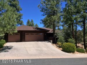 IN THE TREES, close to town, single level AND a 3 car garage!!