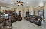 Light & Bright Amazing Panoramic Views Great Room with Custom Floor to Ceiling Stone Fireplace with Remote Control Flame Height & Blower Fan Control, Recessed Lighting, Lighted Ceiling Fan, Ceiling Speakers, Drapes + Pleated Shades, Carpet Flooring & 2 Tone Paint.