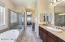 Gorgeous Master Bath feels Like a Spa Retreat! Relaxing Oval Jetted Tub, Glass Block Privacy Window with Remote Control Custom Pleated Window Shade, Seamless Glass Enclosed Shower, Diagonal Tub & Shower Tiled Surrounds, Executive Tall Height Cherrywood Cabinetry with Granite Counters & Raised Sinks, Cabinet Pulls & Handles, Linen Closet, Private Toilet Room, Mirrored Medicine Cabinets & Walk In Closet with Accent Windows & Organizers.