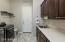 Upgraded Cabinetry, Deep Stainless Utility Sink, Handles & Cabinet Pulls, Tiled Flooring, Accent Window, Folding Counter, Clothes Hanging Bar/Shelf & Direct Entry to the 2 Car Garage.