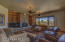 Comfortable and open family room. Many wood framed windows let in natural light to make the room bright. Recessed lighting and Art lighting to highlight your favorite paintings.