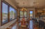 The rustic ranch style chandelier ties together the whole room including the hickory flooring and knotty pine cabinets in the kitchen.