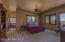 Have a restful night sleep in this spacious master bedroom with easy access the patio. Large wood framed windows frame the view of the mountains. Master walk in closet conveniently located next to master bath