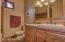 Plenty of counter space in the guest bathroom. Matching flooring, cabinets,and light fixtures. Shower tub combo.