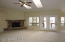 Cozy corner gas FP with mantle, great room has high ceilings and skylights, bright and airy!