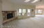 Great room opens to covered rear deck and open bricked patio area.