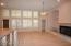 Large Great Room features beautiful wood Plantation Shutters...