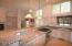 Kitchen features stunning granite counter tops and...
