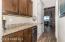 Handy Wine Counter with Granite Top, Wine Refrigerator, Under Counter Lighting, Upper & Lower Cabinets + Double Door Media/Storage Closet.